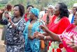 Women Representative Mary Seneta (2nd r) with Rongai Ward aspirant Margret Mbote (r) in a dance before giving out Affirmative Action Funds cheques to groups from Kajiado North Sub County recently. Photo/Obegi Malack