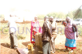 Residents of Nkaroni take water during the commissioning of a  water tank at Inkisanjani by CDF