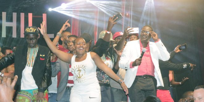 Churchill and his  fans join in singing a gospel song as they usher in New Year 2018 at Galaxy Resort in Kitengela town. Fans  thronged to the venue to watch Churchill show live recording. Photo/Michael Opiyo