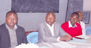 Keekonyokie Ward MCA Moses Kusero (in red pullover), Japhet Saruni  (left) Kajiado West Sub-county administrator  during a meeting in Kiserian to review development projects. Photo/Obegi Malack
