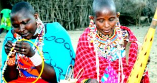 Women from Engong'u Narok in Amboseli doing what they like most. Beadiwork is their main source of livelihood. Photo/ Moses Saruni