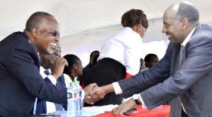 Kajiado County assembly Speaker Johnson Osoi shakes hands with  former  Kajiado County Commissioner Harsama Kello at a past function. File photo