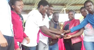 Members of one of the winning teams are all smiles as after receiving their trophy.
