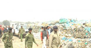 Ngong OCPD George Seda and other leaders walk in Ngong dumpsite during avisit by top leaders led by Governor Joseph ole Lenku.Photo By Obegi Malack