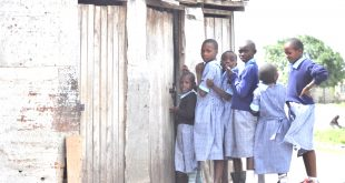 Pupils at the school queue at the only available toilet which they share with  teachers.