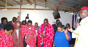 Huduma Centre Bishop Joel Kimani prays for Governor Joseph ole Lenku, Kajiado North MP Joseph Manje, MCAs James Waisha and Lucy Washuka during the Huduma Christian Revival conference in Rongai recently.