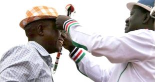 Raila Odinga places a hat on Tarayia Kores as a sign of blessing for 2022 race at Dalalekutuk, Kajiado Central during a political rally recently. Photo/Kurgat Marindany